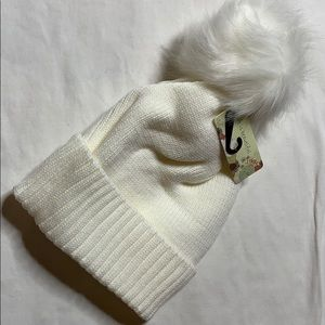 Cozy white winter hat with fuzzy top. Brand New